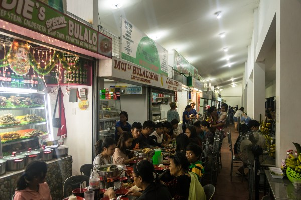 Bulalo vendors at the Mahogany Market by Alexander Synaptic via Flickr