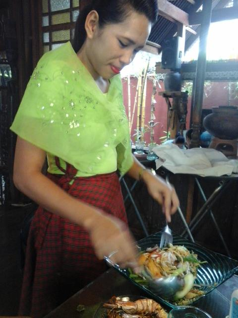 Friendly server in traditional Filipino attire