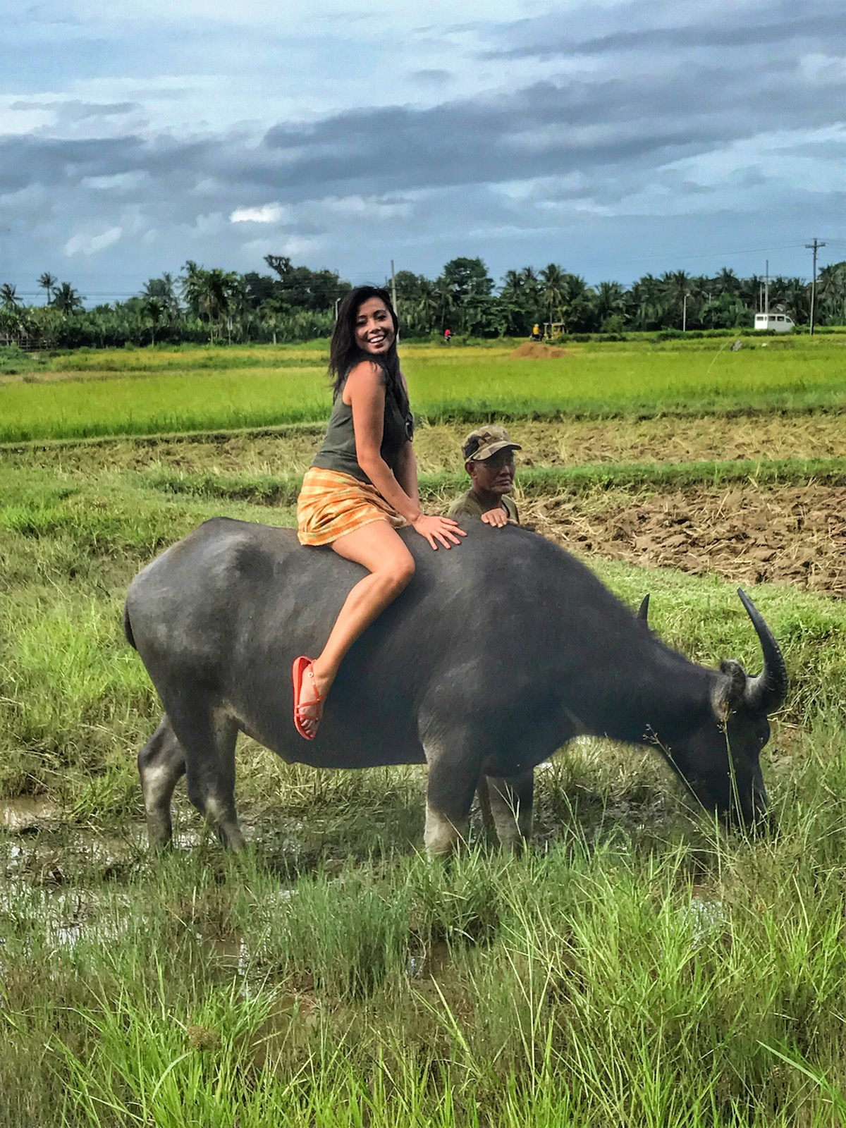 Grant-seizes-the-moment-to-ride-a-carabao-water-buffalo-in-the-rice-fields-of-Motag-Living-Museum-beside-Boracay-Philippines - Si Bugsay ug ang amigong Kabaw - Tira-Pasagad | Saksak-Sinagol