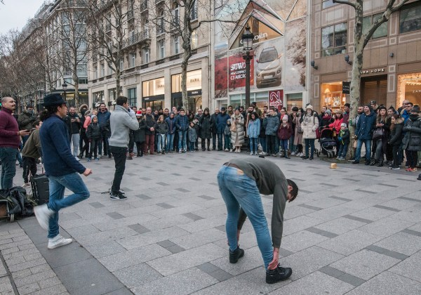 Street entertainers performing their dance routine in Champs Elysees.