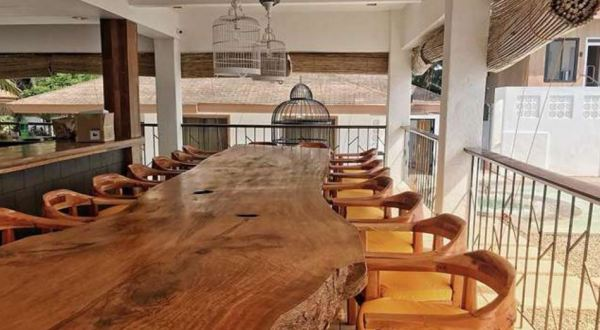 Long wooden table inside the resort. Photo via Soler Sea official facebook page.