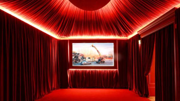 Cinema Da Camera - a small, red-velvet tented cinema auditorium where the audience can watch experimental films. Image via CNN.