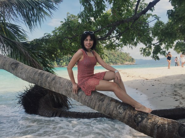 The lovely Ms. Frances of Inquirer posing at the bent over coconut tree in Inaladelan