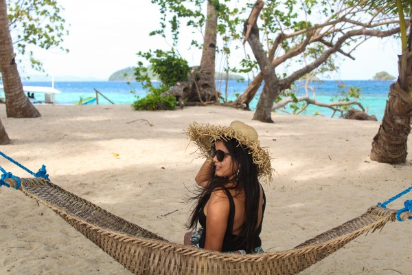 Here's Ms. Karla of karlaaroundtheworld sitting in the hammock.