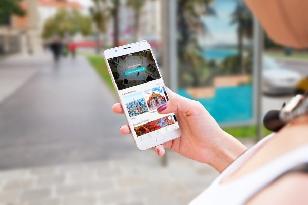 Travel booking website in mobile phone screen