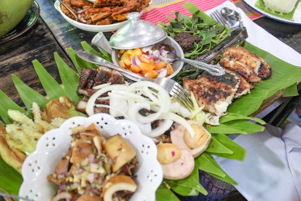 Inihaw platter consists of grilled liempo, salted egg, eggplant, fried bangus, and squid. Php 899 pesos.