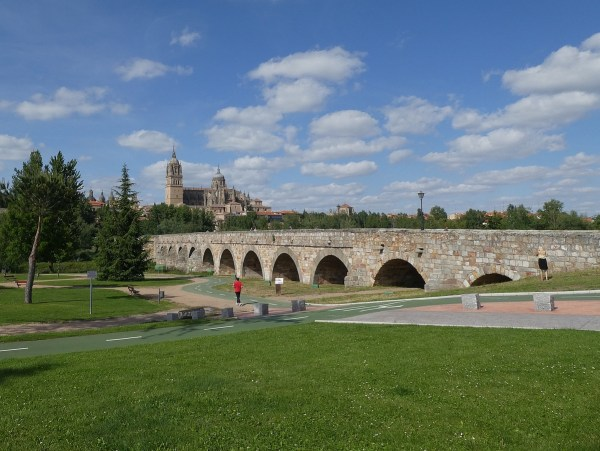"Ancient Roman bridge into Salamanca, with the ""new"" Cathedral in the background."