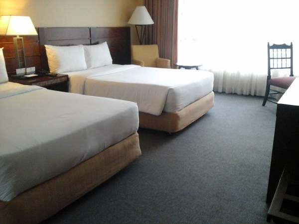Huge beds at the one deroom suites of The Forest Lodge