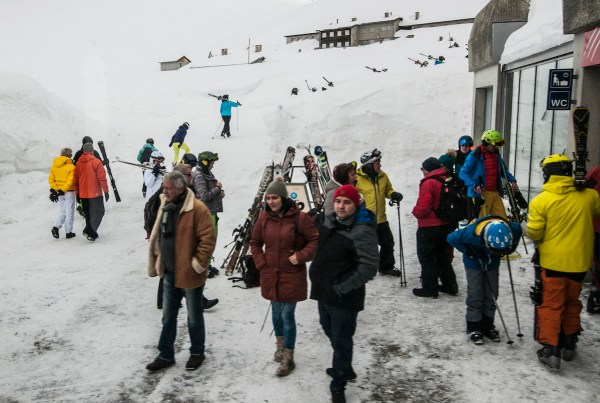 Skiers on the way to the resorts around OberAlp Pass.