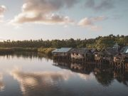 Stilt houses in siargao photo by Jeremy Perret via Unsplash
