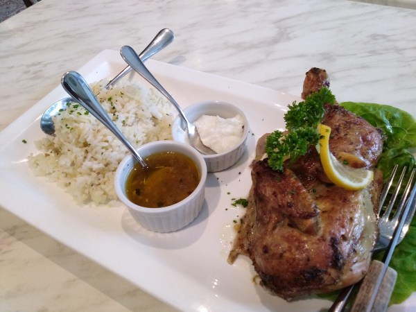 The Relish Roasted Chicken - the dish is marinated in garlic cloves, oregano, and lots of lemon