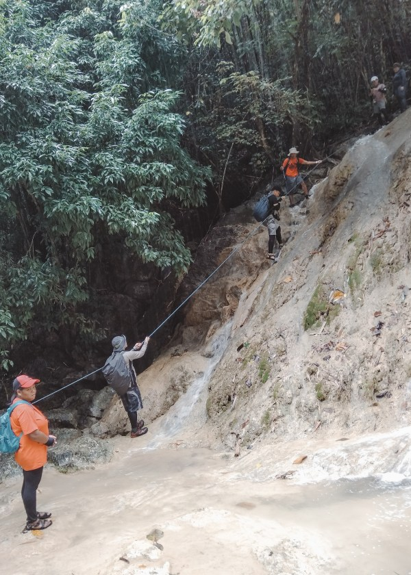 Rappelling down to Mahangin Falls