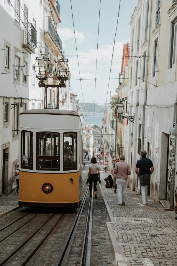 Streetcars in Lisbon by Nik Guiney via Unsplash