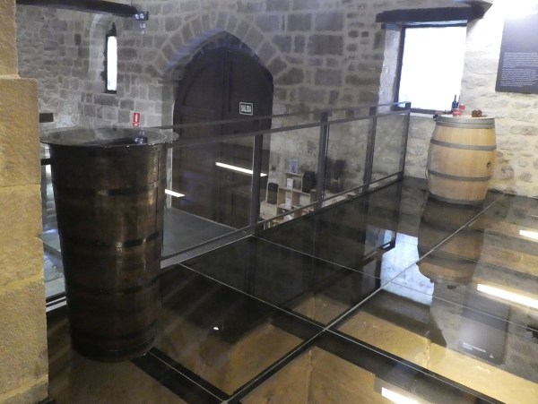 Glass floors over the vats where the grapes were pressed