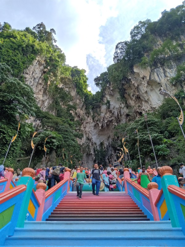 The colorful steps lead up to the Batu Caves Hindu temple