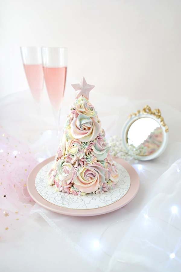 Twinkle like the star atop of a Christmas tree with Twinkle, Twinkle, a tiered cake designed in the shape of the iconic Christmas tree