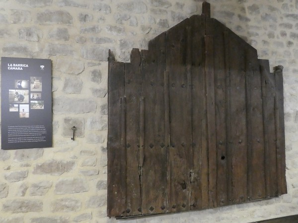 Original door and key from 11th century hangs on the wall