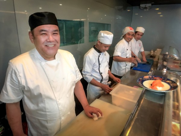 Executive chef Keita Kamimoto whips up sumptuous Kitsho's delectable ramen and Japanese dishes with his F&B team.