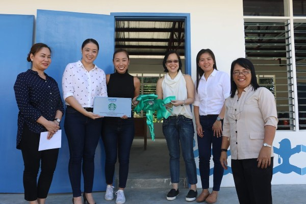 Friends of Hope, Starbucks and school officials lead the unveiling of the new classrooms. Photo shows (from the left) GenerationHope Inc Commerical Director Bambi Defensor, Starbucks Philippines marketing manager Jo-Ann Ramos, Starbucks Philippines category manager Jamie Silva, Starbucks Philippines assistant category manager for food Celine Lichauco, and AECMIS principal Felisa Cabaobas.