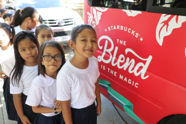 AECMIS students are excited to sample the Starbucks beverages prepared in the Starbucks Venti Van which visited their school in San Fernando, Pampanga.