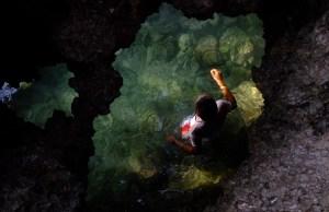 Hidden pool under a rock formation. Photo by Ram Cambiado
