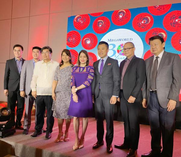 Tourism Secretary Bernadette Romulo-Puyat joins Megaworld executives and officers of the Chinese federation, in the ceremonial fortune cookie cracking at the opening of the 8th hotel and the 5th hotel brand under Megaworld Hotels, Hotel Lucky Chinatown.