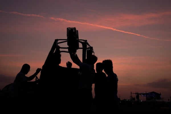 Pilots and chase crew set up their balloons as early as 5am. Photo by Ramir G. Cambiado