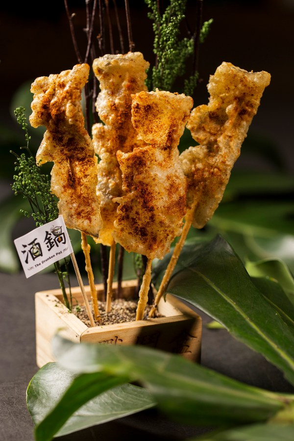 "Also on the promotional Father's Day menu are specialty items including a crispy, spicy, deep-fried ""CROCPop"" snack of crocodile tail meat, perfect with beer before a hot pot feast"