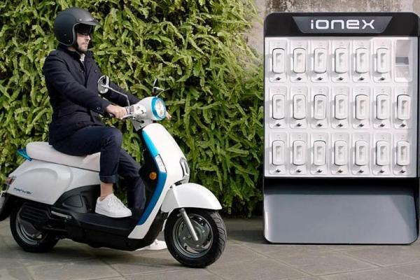 Kymco's Ionex electric scooter featuring a vending machine type battery charging station