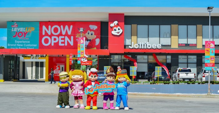 Jollibee and Friends welcome customers to the opening of Jollibee Petron SLEX, the fastfood chains latest Level Up Joy Store and 1,200th in the Philippines.