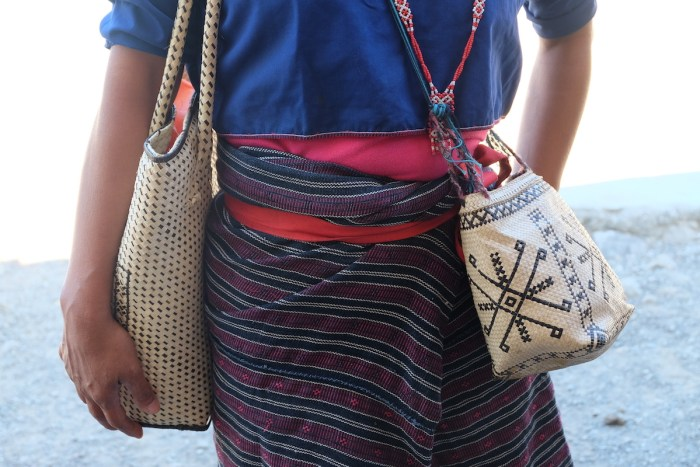 Mansalay Hanunuo Women wearing traditional woven cloth and woven bags