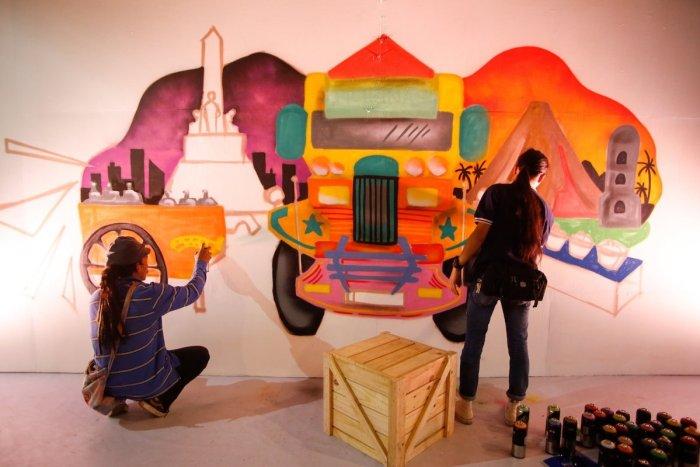 Filipino Artists painting murals