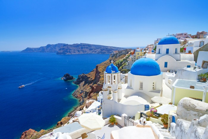 Architecture of the village of Oia on a photo of Santorini Island via Depositphotos