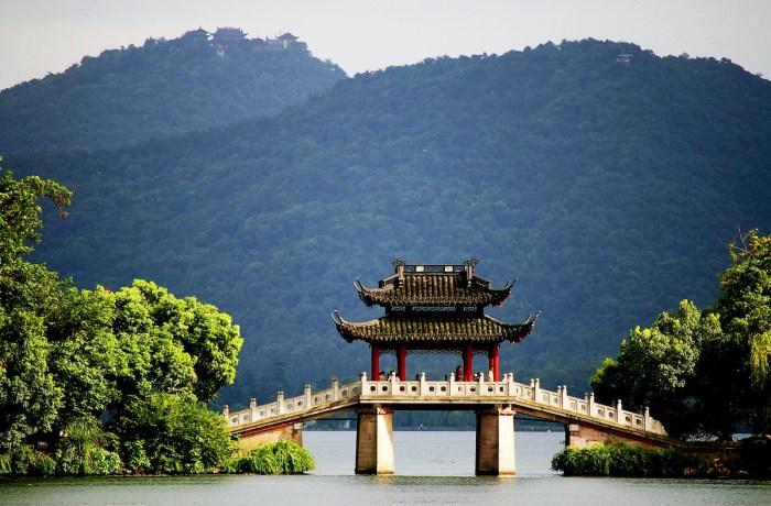A pavilion bridge in west lake, hangzhou, china via Depositphotos