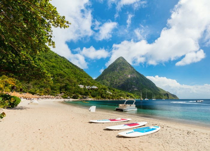 Home.fit Idyllic-white-sand-tropical-beach-with-view-to-Piton-mountains-in-Saint-Lucia-photo-via-Depositphotos 15 Best Tropical Vacation Destinations Around The World