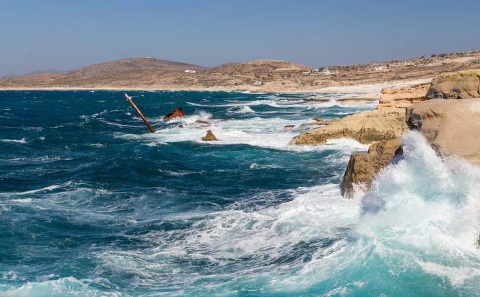 Rough sea at Sarakiniko shipwreck, Milos island photo via Depositphotos