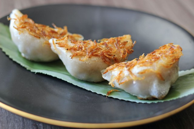Pan-fried Minced Pork Chive Dumplings topped with Sakura Shrimp