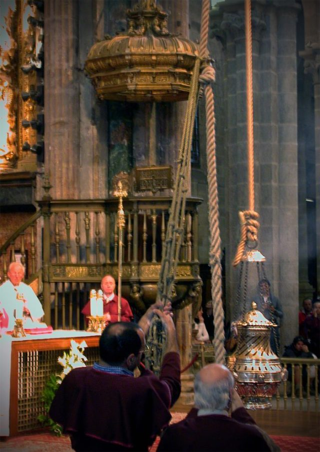 """This is the Botafumeiro (Galician for """"smoke expeller""""), a giant incense metal container that is swung over the people during the Mass from a suspended pulley mechanism in the dome on the roof of the church."""