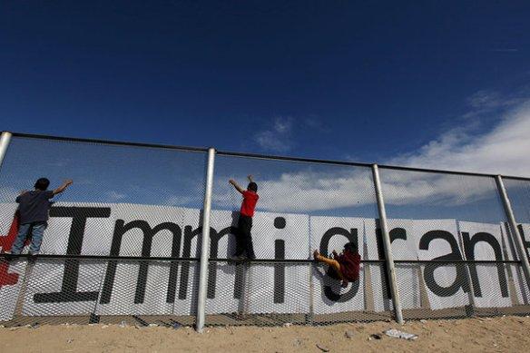 974433_1_0406-border-fence-climb_standard