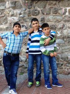 Teenage boys pose before Galata Tower, filled with swagger, but at the same time a certain shyness. ~ Elizabeth Titus