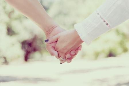 A strong couple holding hands. Outside the Norm Counseling offers marriage counselors & relationship therapy in Temecula, CA. 92591