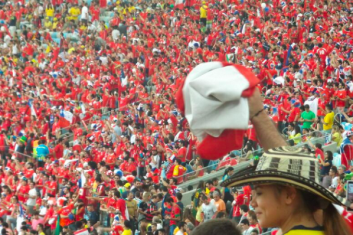 Chilean fans paint the Maracanã red versus Spain.