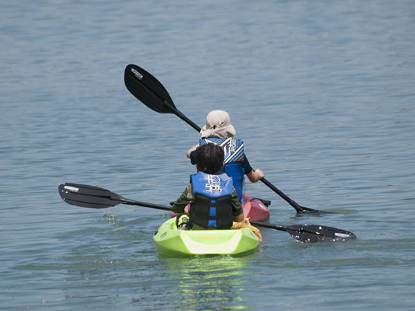 Photo of two young children in a kayak.
