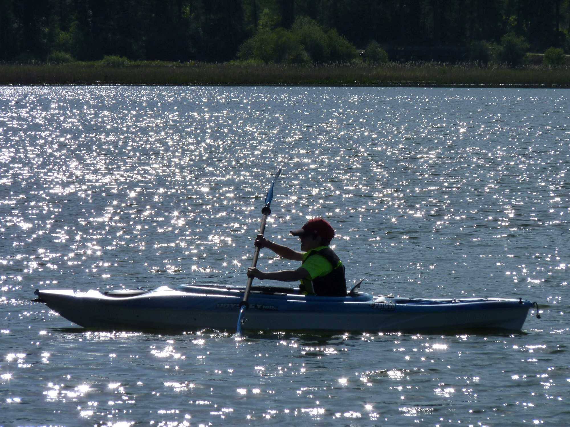 A young boy kayaking.
