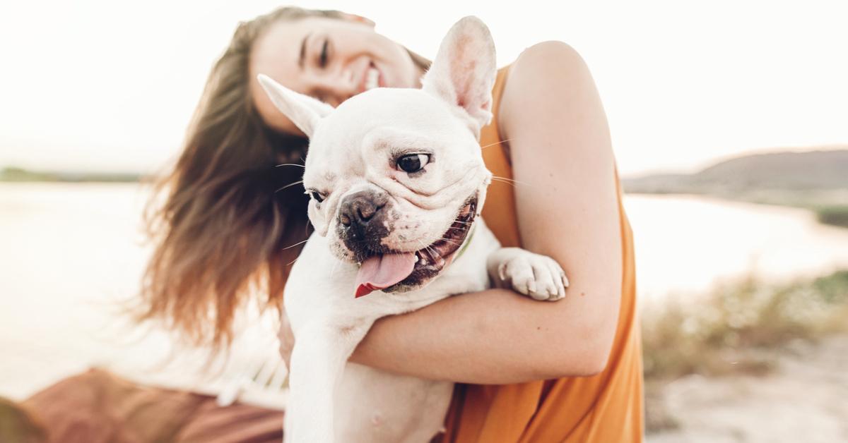 do dogs need sunscreen? woman and dog on beach