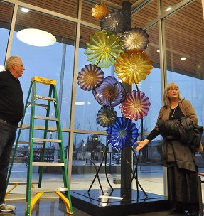 Former Sequim city manager Steve Burkett and Sue Ellen Riseau, executive director of the Olympic View Community Foundation, unveil a sculpture at the Sequim Civic Center on Friday, Feb. 5, dedicated to Burkett's late wife, Bobbi.— image credit: Sequim Gazette photo by Michael Dashiell