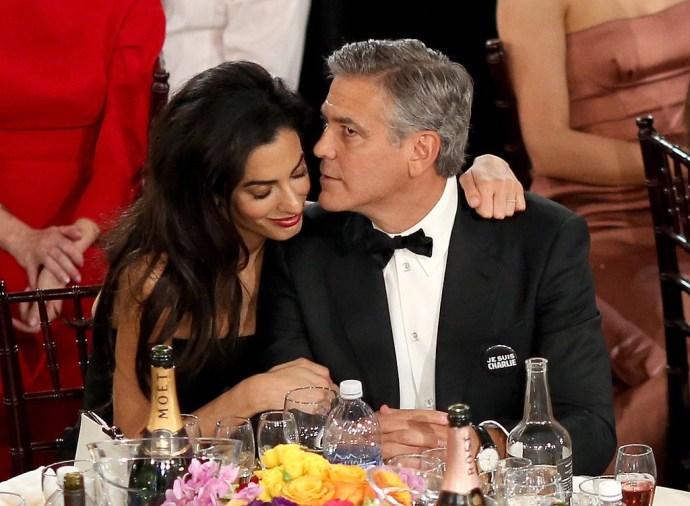Amal-Alamuddin-cuddled-up-George-Clooney