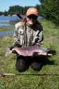 A young female poses with her 8.25 -pound Sockeye Salmon on the Kenai-Russian River in Alaska.