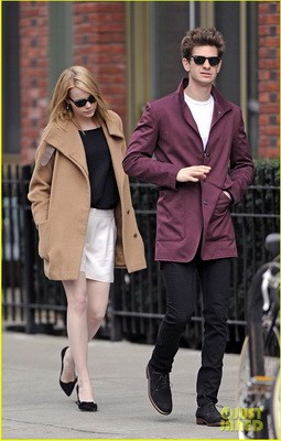 Emma Stone tries to keep a low profile as she hides behind her boyfriend Andrew Garfield while out on a romantic stroll in NYC