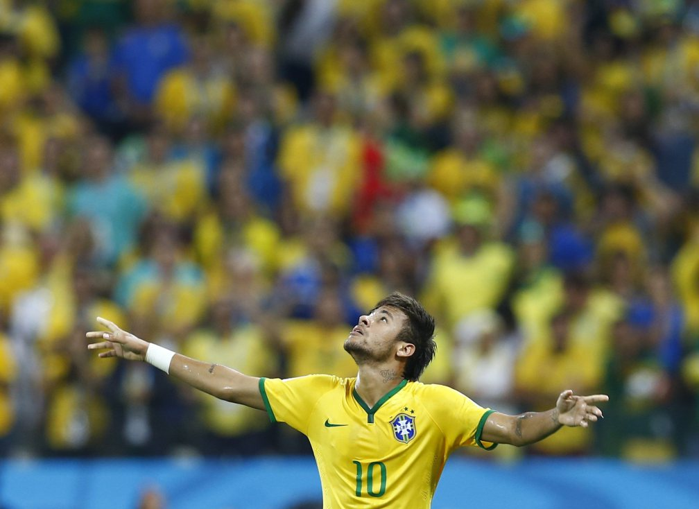 Brazil's Neymar celebrates a goal during the 2014 World Cup opening match between Brazil and Croatia at the Corinthians arena in Sao Paulo